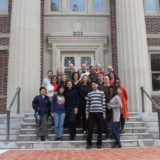 Five of the 25 Obama Foundation Scholars, along with their own families, Sag Harbor hosts and other friends and community members, paused for a moment outside the John Jermain Memorial Library after Saturday's welcome breakfast. Christine Sampson photo